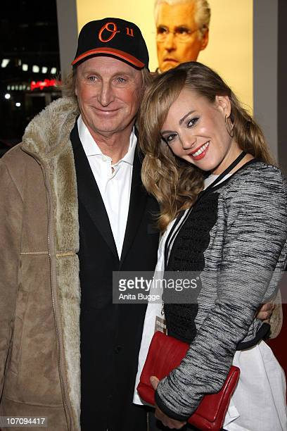 Comedian Otto Waalkes and his wife Eva Hassmann attend the premiere of 'Otto's Eleven' at CineStar on November 23, 2010 in Berlin, Germany.