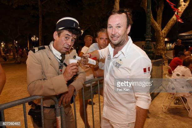 Comedian Patrick Chagnaud known as Le Gendarme de Saint Tropez and Jean-Christophe Sibelya owner of Wine Domaine Bertaud Belieu attend the AJILA...