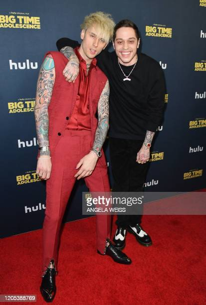 """Comedian Pete Davidson and US rapper Machine Gun Kelly attend the premiere of Hulu's """"Big Time Adolescence"""" at Metrograph on March 5, 2020 in New..."""