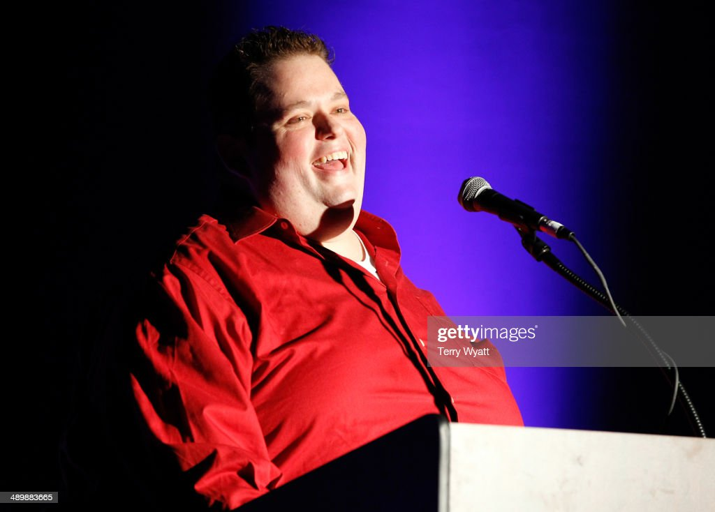 Comedian Ralphie May speaks onstage during the T.J. Martell Ambassador Of The Year Awards at The Rosewall on May 12, 2014 in Nashville, Tennessee.