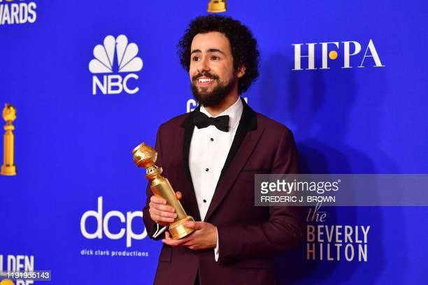 US comedian Ramy Youssef poses in the press room with the award for Best Performance by an Actor in a Television Series Musical or Comedy during the...