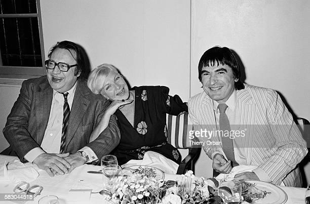 Comedian Raymond Devos and actor Serge Lama help celebrate Line Renaud's birthday.