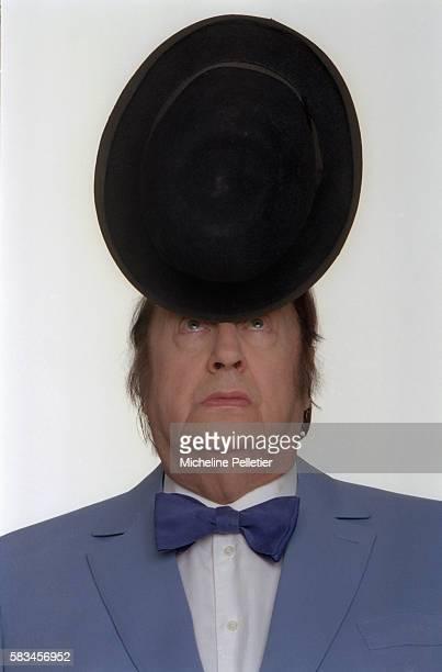 Comedian Raymond Devos Balancing Hat on Nose