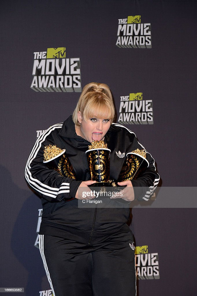 Comedian Rebel Wilson poses backstage during the 2013 MTV Movie Awards at Sony Pictures Studios on April 14, 2013 in Culver City, California.
