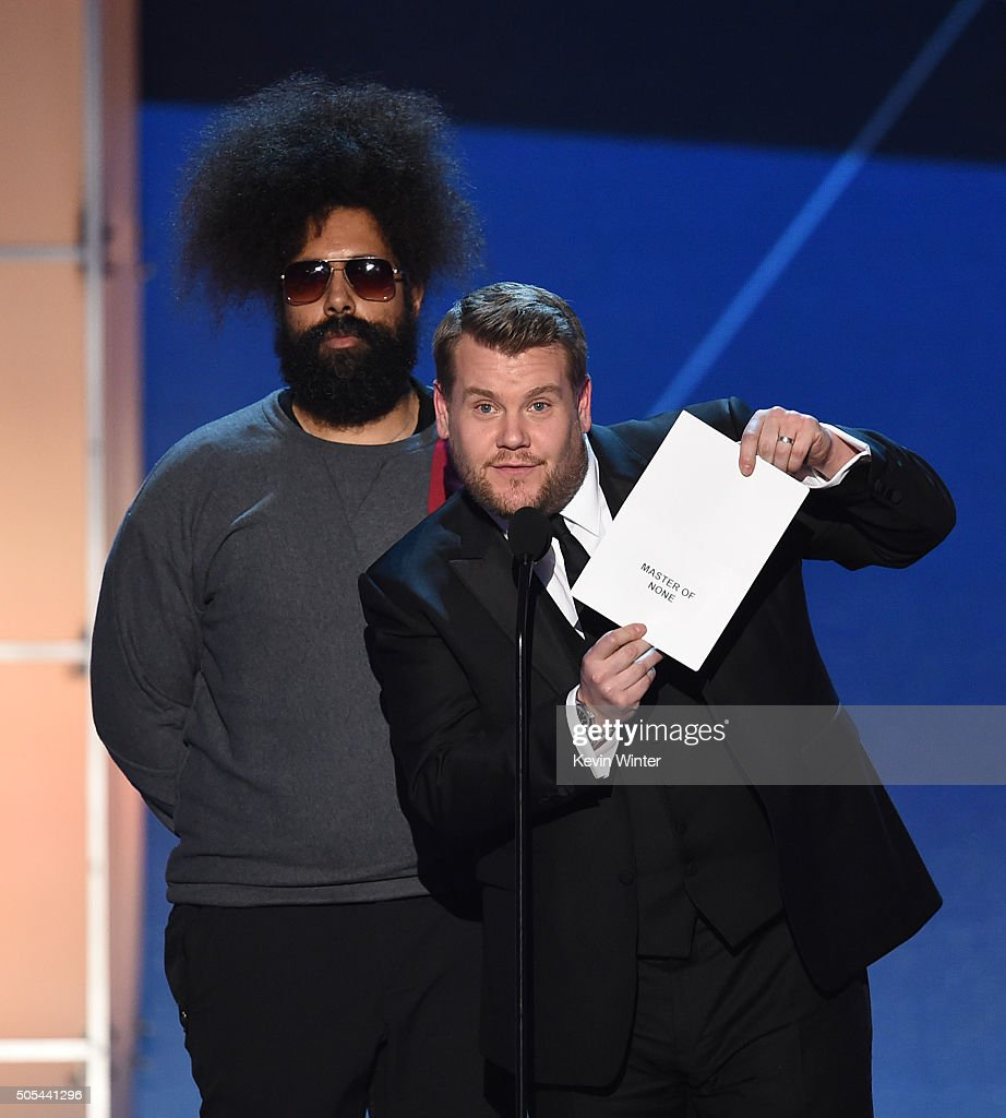 Comedian Reggie Watts and TV personality James Corden speak onstage during the 21st Annual Critics' Choice Awards at Barker Hangar on January 17, 2016 in Santa Monica, California.