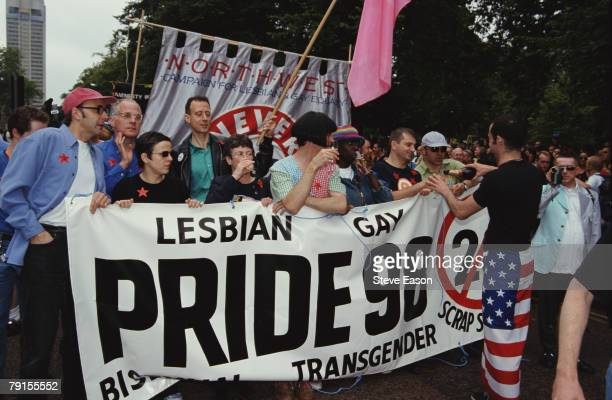 Comedian Rhona Cameron and political activist Peter Tatchell help to hold a banner at the Lesbian Gay Bisexual and Transgender Pride event London 4th...