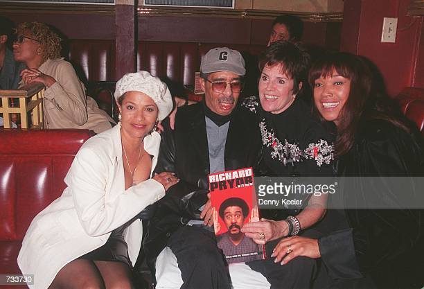 Comedian Richard Pryor poses with actress Debbie Allen left producer Jennifer Lee and singer Anita Pointer right at the Laugh Factory comedy club to...