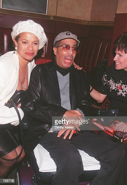 Comedian Richard Pryor poses with producer Jennifer Lee right and actress Debbie Allen at the Laugh Factory comedy club to promote Pryor's 9 box CD...