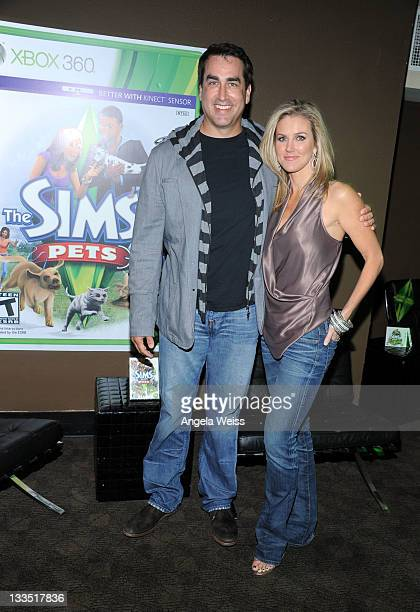 Comedian Rob Riggle and Tiffany Riggle pose in the VIP Lounge at Variety's Power of Comedy Presented By The Sims 3 Benefiting The Noreen Fraser...