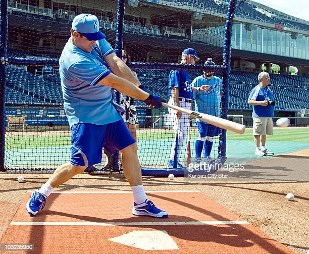 Comedian Rob Riggle take a turn in the batting cage before the game between the Kansas City Royals and Detroit Tigers at Kauffman Stadium in Kansas...