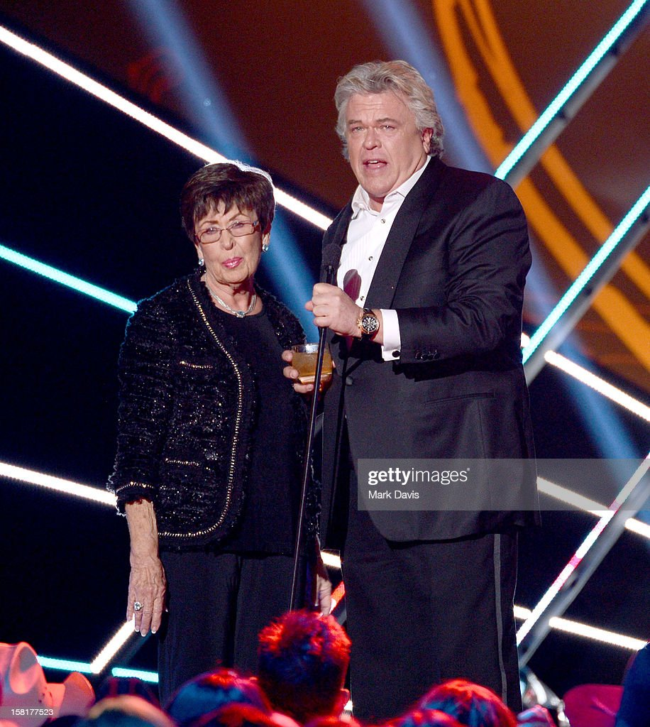 Comedian Ron White (R) and his mother Barbara Oliver speak onstage during the 2012 American Country Awards at the Mandalay Bay Events Center on December 10, 2012 in Las Vegas, Nevada.