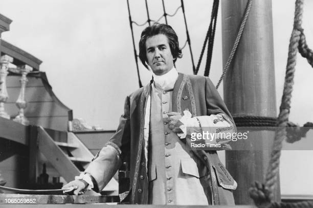 Comedian Russ Abbot standing on the deck of a ship whilst dressed as an old fashioned naval officer in a sketch from the television series 'The Russ...
