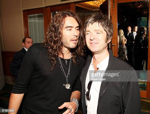 Comedian Russell Brand and Musician Noel Gallagher attend The O2 Silver Clef Awards Cocktail Party in aid of NordoffRobbins Music Therapy at The...