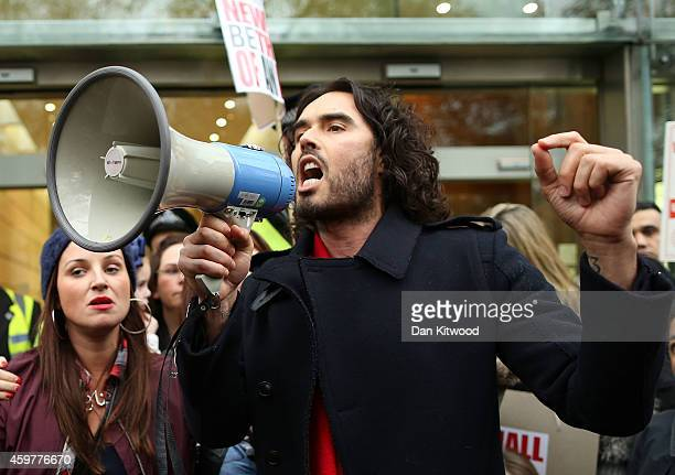 Comedian Russell Brand joins residents and supporters from the New Era housing estate in East London as they demonstrate against US investment...