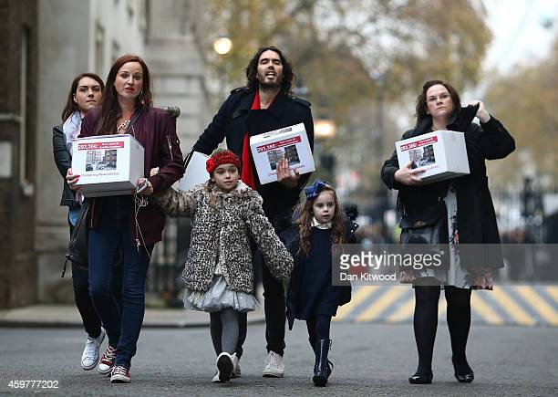 Comedian Russell Brand joins residents and supporters from the New Era housing estate in East London as they deliver a petition to 10 Downing Street...