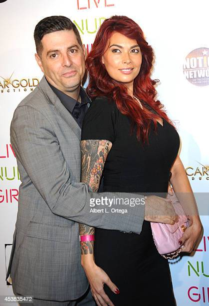 Comedian Sam Tripoli and adult film star Tera Patrick arrive at the premiere of Live Nude Girls held at Avalon on August 12 2014 in Hollywood...