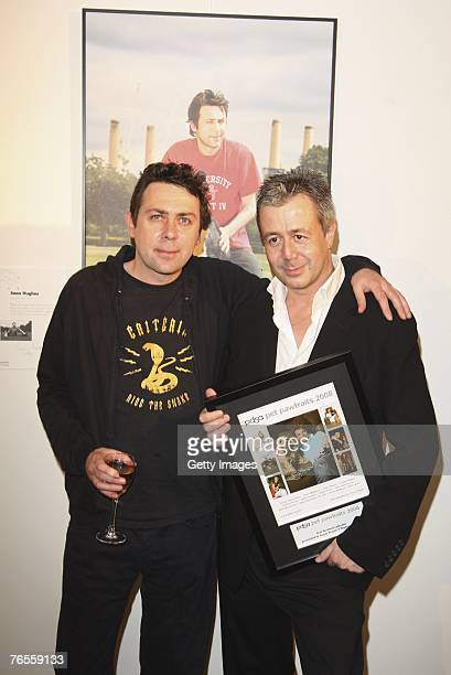 Comedian Sean Hughes and Jason Fraser pose infront of Seans calendar photograph with Seans crossbreed dogs Sweep and Betty at the Launch of the 2008...