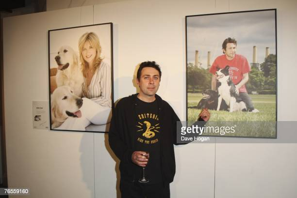 Comedian Sean Hughes poses infront of his calendar photograph with his crossbreed dogs Sweep and Betty at the Launch of the 2008 Pdsa Calendar...