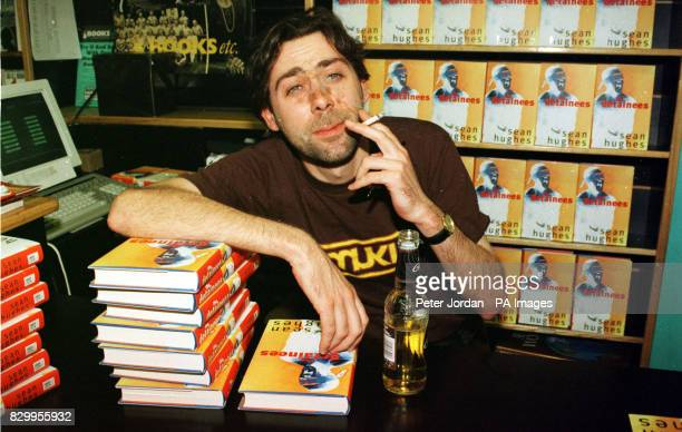 Comedian Sean Hughes takes a break from signing his debut novel 'The Retainers' and enjoys a cigarette in Books Etc in London