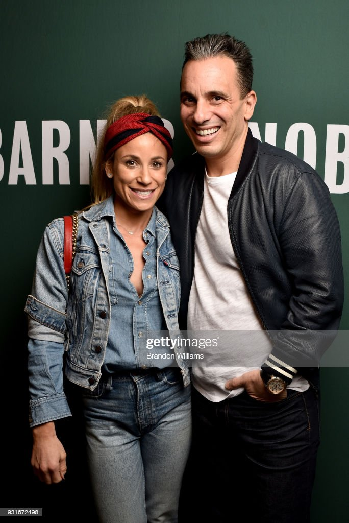 Comedian Sebastian Maniscalco and his wife Lana Gomez pose