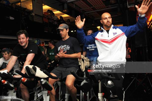 Comedian Seth Meyers and New York Giants Linebacker Mark Herzlich cycle at the 2012 Cycle For Survival - Day 2 at Equinox Graybar on February 12,...