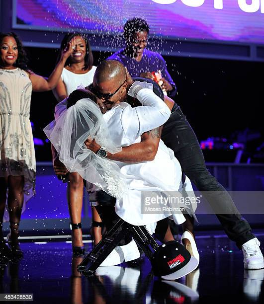 Comedian Sheryl Underwood and actor Shemar Moore present onstage at the 2014 Ford Neighborhood Awards Hosted By Steve Harvey at the Phillips Arena on...
