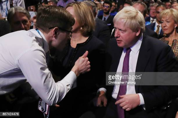 Comedian Simon Brodkin aka Lee Nelson gives the thumbs up to Foreign Secretary Boris Johnson after handing Prime Minister Theresa May a P45 during...