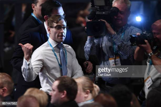 Comedian Simon Brodkin, aka prankster Lee Nelson, gestures as he leaves the hall after handing Prime Minister Theresa May a P45 during her keynote...