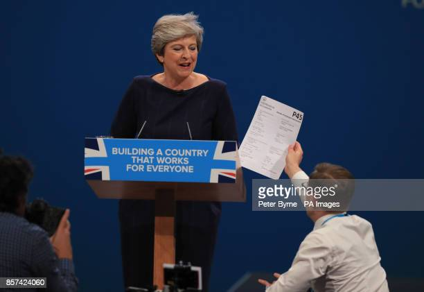 Comedian Simon Brodkin, also known as Lee Nelson confronts Prime Minister Theresa May during her keynote speech at the Conservative Party Conference...