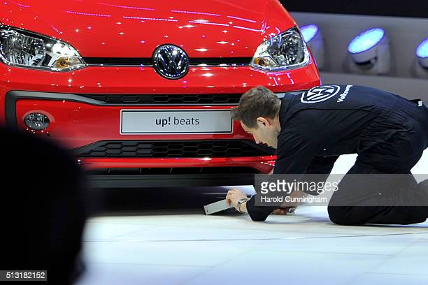Comedian Simon Brodkin disrupts the Volkswagen press conference during the Geneva Motor Show 2016 on March 1, 2016 in Geneva, Switzerland.