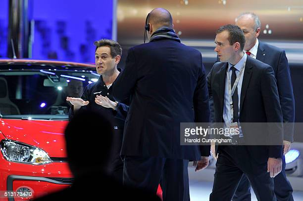 Comedian Simon Brodkin is removed as he disrupts the Volkswagen press conference during the n March 1 2016 in Geneva Switzerland