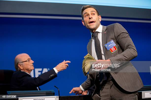 Comedian Simon Brodkin prepares to attack FIFA President Joseph S. Blatter with money during a press conference at the Extraordinary FIFA Executive...