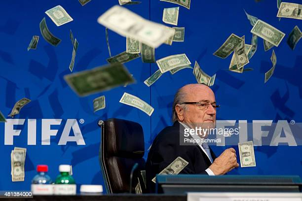 Comedian Simon Brodkin throws cash at FIFA President Joseph S. Blatter during a press conference at the Extraordinary FIFA Executive Committee...