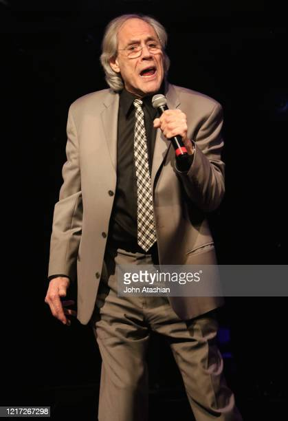 """Comedian, singer and actor Robert Klein is shown performing on stage during a """"live"""" stand up appearance on November 8, 2015"""