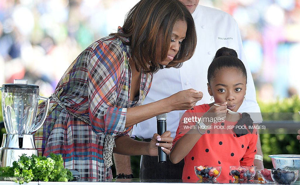 President obama and family host the annual celebration of easter comedian skai jackson from the comedy series jessie makes a fruits salad with first lady michelle negle Images