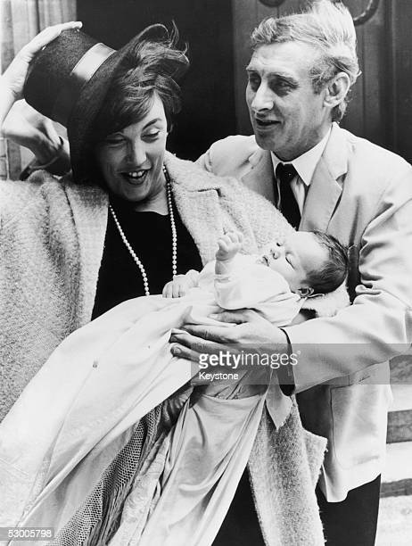 Comedian Spike Milligan with his wife Paddy and five-week-old daughter Jane Fionulla Marion Milligan outside St Albans Roman Catholic Church, North...