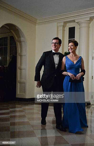 Comedian Stephen Colbert and his wife Evie arrive at the White House in Washington on February 11 2014 for the state dinner in honor of French...