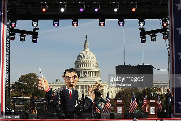 Comedian Stephen Colbert and John Oliver perform with a giant papiermache puppet of Colbert at the Rally To Restore Sanity And/Or Fear on the...