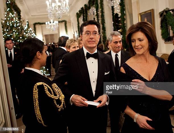 Comedian Stephen Colbert arrives with his wife Evelyn McGeeColbert for a Kennedy Center Honors reception in the East Room of the White House on...