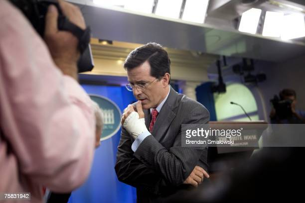 Comedian Stephen Colbert pauses during the taping of a skit at the White House July 27 2007 in Washington DC Stephen Colbert host of the news satire...