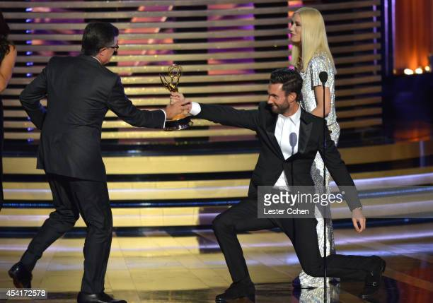 Comedian Stephen Colbert singer Adam Levine and singer Gwen Stefani appear onstage at the 66th Annual Primetime Emmy Awards held at Nokia Theatre LA...