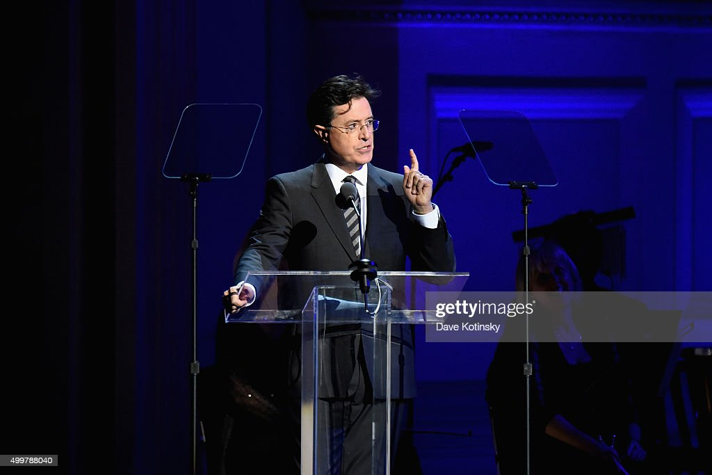 Comedian Stephen Colbert speaks on stage during the ONE Campaign and (RED)'s concert to mark World AIDS Day, celebrate the incredible progress that's been made in the fights against extreme poverty and HIV/AIDS, and to honor the extraordinary leaders, dedicated activists, and passionate partners who have made that progress possible at Carnegie Hall on December 1, 2015 in New York City.