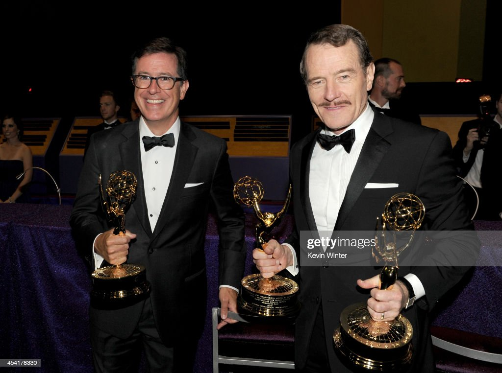 Comedian Stephen Colbert (L), winner of the Outstanding Variety Series for 'The Colbert Report' and actor Bryan Cranston, winner of Outstanding Drama Series and Outstanding Lead Actor in a Drama Series for 'Breaking Bad,' attend the 66th Annual Primetime Emmy Awards Governors Ball held at Los Angeles Convention Center on August 25, 2014 in Los Angeles, California.