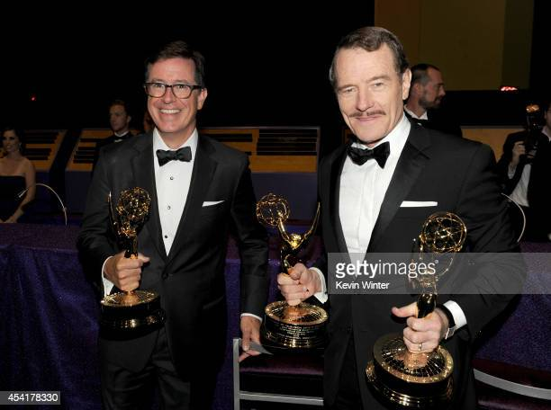 Comedian Stephen Colbert winner of the Outstanding Variety Series for 'The Colbert Report' and actor Bryan Cranston winner of Outstanding Drama...