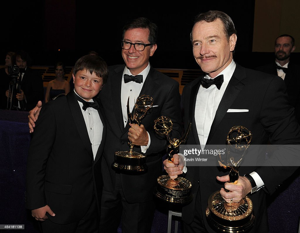 Comedian Stephen Colbert (C) winner of the Outstanding Variety Series for 'The Colbert Report', his son (L), and actor Bryan Cranston (R), winner of Outstanding Drama Series and Outstanding Lead Actor in a Drama Series for 'Breaking Bad,' attend the 66th Annual Primetime Emmy Awards Governors Ball held at Los Angeles Convention Center on August 25, 2014 in Los Angeles, California.