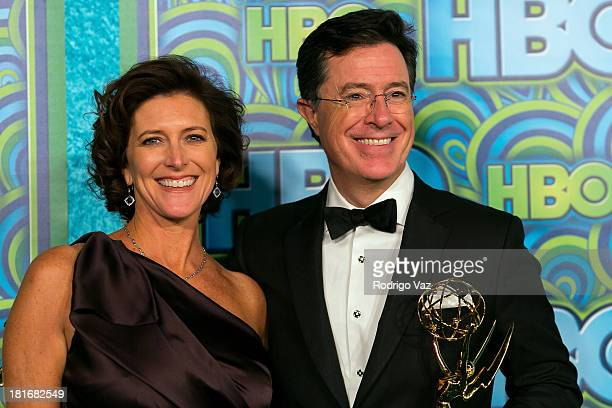 Comedian Stephen Colbert with his award for Outstanding Variety Series won for 'The Colbert Report' and wife his Evelyn McgeeColbert arrive at HBO's...