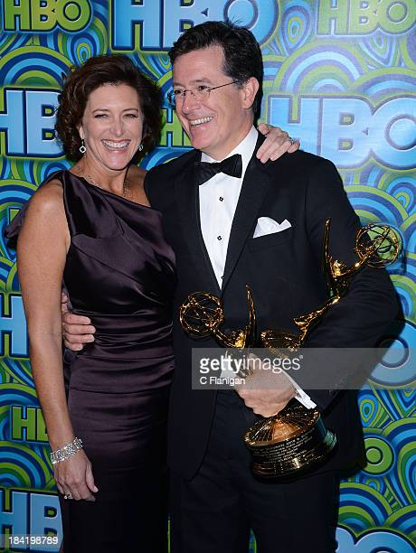 Comedian Stephen Colbert with his awards for Outstanding Variety Series won for 'The Colbert Report' and wife his Evelyn McgeeColbert arrive at HBO's...