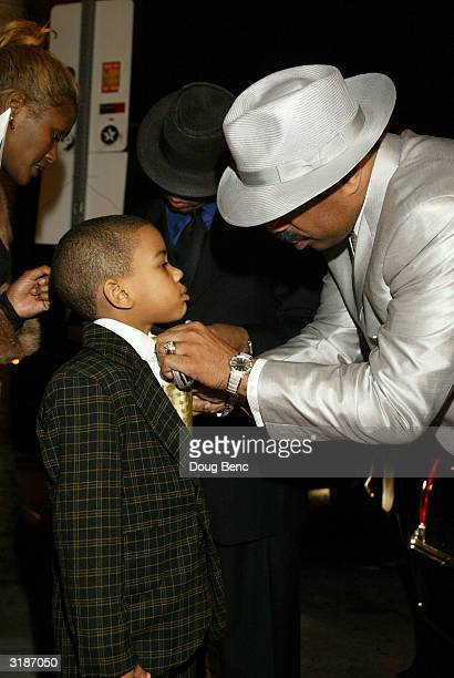 Comedian Steve Harvey helps his son Wynton fix his tie during the the premier of Johnson Family Vacation at the Cinerama Dome on March 31 2004 in...