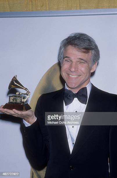 Comedian Steve Martin holds up the Grammy that he won for his album Let's Get Small at the Shrine Auditorium on February 23 1978 in Los Angeles...
