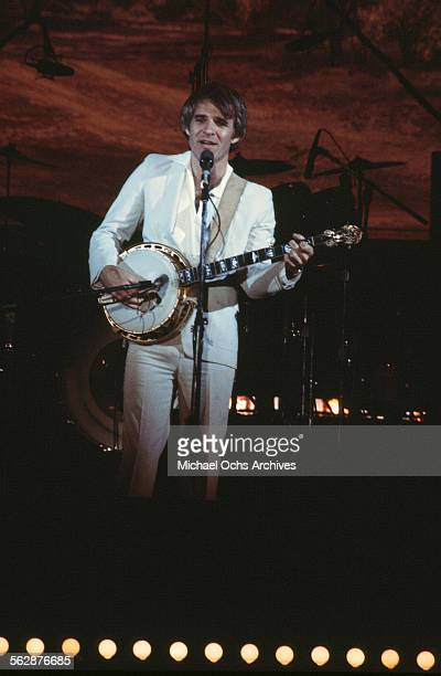Comedian Steve Martin plays the banjo onstage in a concert in Los Angeles California